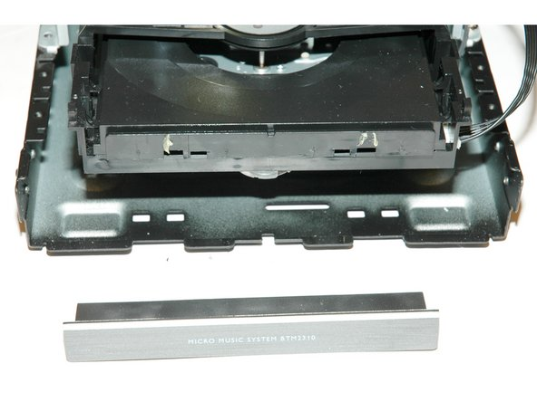 Open tray and unclip front of tray