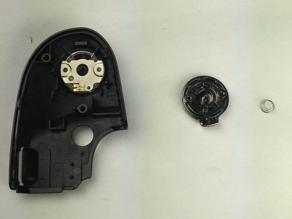 The shutter component has a spring attached. Be sure to carefully remove the shutter button and keep track of the small spring.