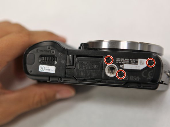 Use a Phillips head 000 screwdriver to remove the three 4.0mm screws on the bottom of the camera.