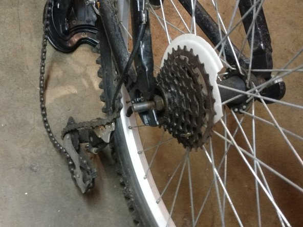 Once taken off you can remove the chain off of the tire. Be careful and do not pull to hard.
