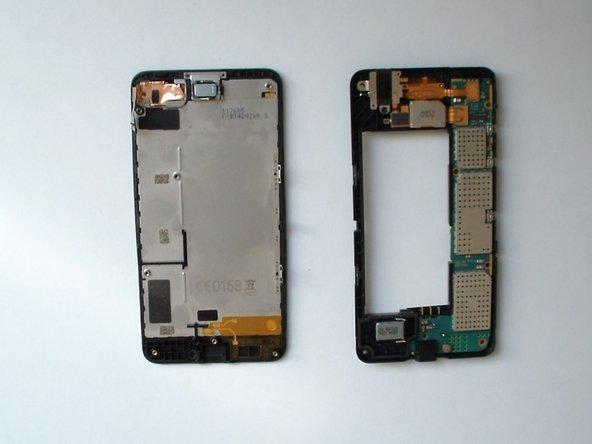 Image 3/3: Careful unhook the display assembly flex cable.