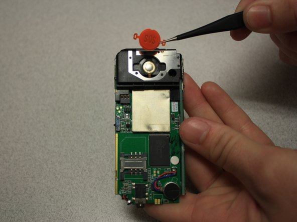 Remove SOS button from circuit board with tweezers.