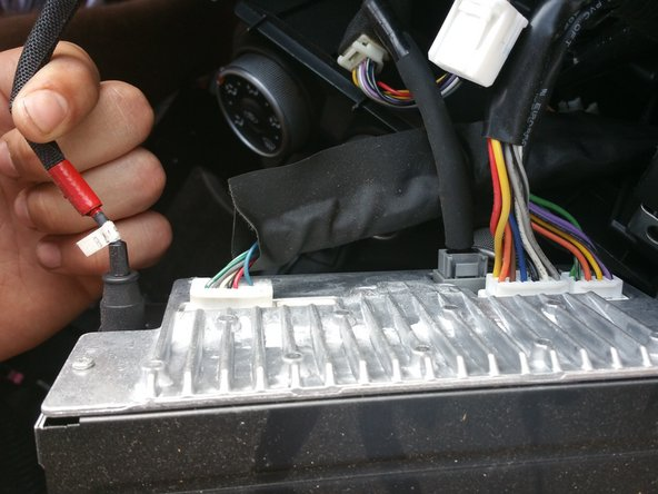 Remove each bundle of wires that is connected to the back of the head unit.