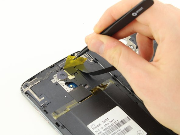 Remove the yellow Kapton tape by using the tweezers to peel it up and away from the device.