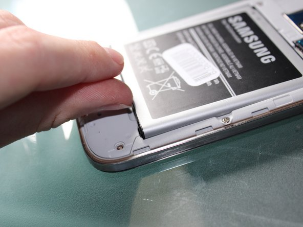 Simply remove the battery using your fingernail or spudger. No cables are attached so it is basic.