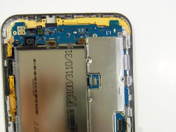 Image 2/2: With the same tool release the camera flex cable from its socket.