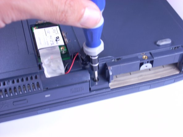 Using a Phillips screwdriver, unscrew and remove one F6 screw from beneath the modem.
