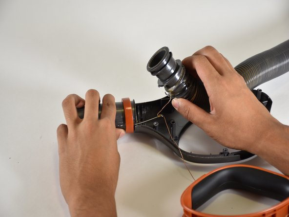 Using your hands, pull the tube from the nozzle of the handle.