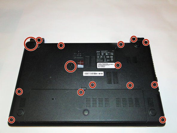 Using a Phillips 1 screwdriver, remove the 17 9 mm screws from the bottom of the laptop, including the one in the back panel.