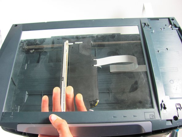 Once you have removed the four torx screws, gently lift the scanner glass cover from the printer's base.
