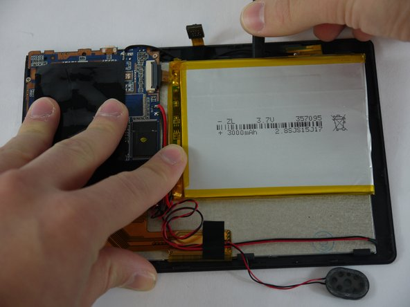 Using a nylon spudger, slowly work your way underneath the battery separating it from the panel beneath.