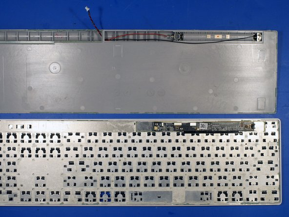 With the keyboard apart, it is evident that Microsoft used double sided tape around each key and glue on the exterior keyboard edge.