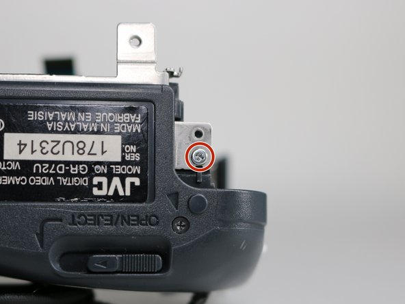 Remove the 4.3 mm screw on the bottom of the camera frame.