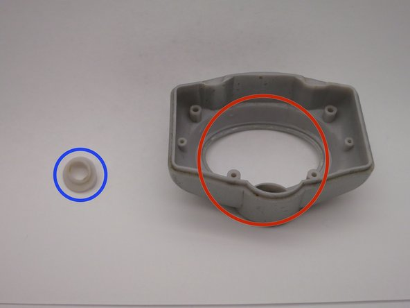 Plastic button insert - circled in blue
