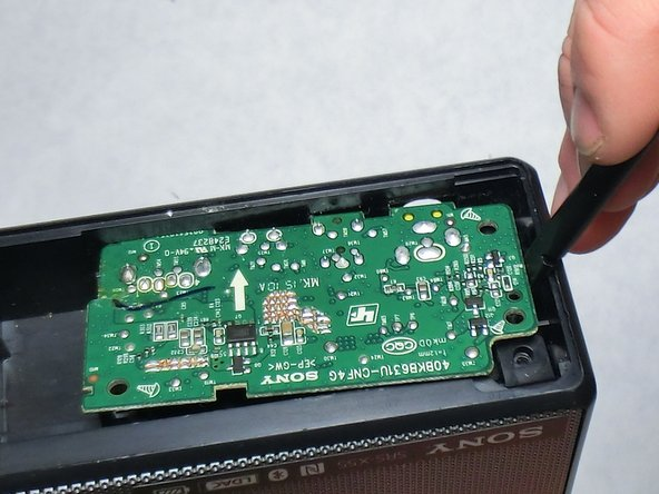 Use a plastic spudger to remove the I/O board from the speaker body.