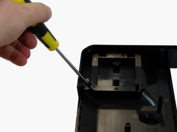 Push the rod out by using the screwdriver as a lever.