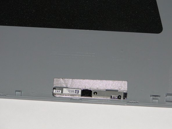 Carefully detach the camera from the back bezel using a spudger and careful upward pressure.