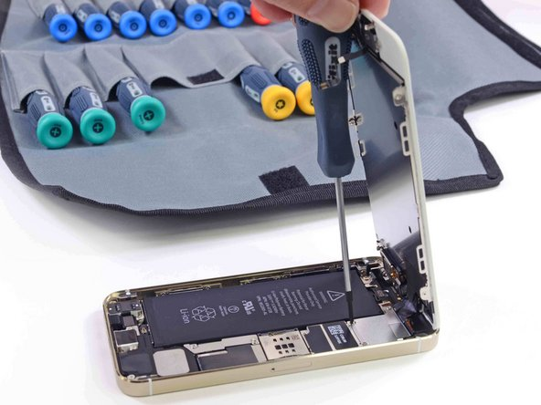 Image 1/3: The missing battery pull-tab, though  seemingly innocuous, indicates a bigger problem for battery repair: glue.