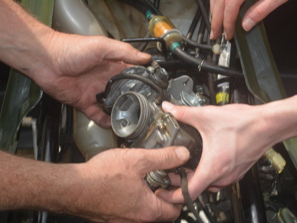 Remove the choke cable attached to the carburetor by twisting the carburetor around to unscrew it.