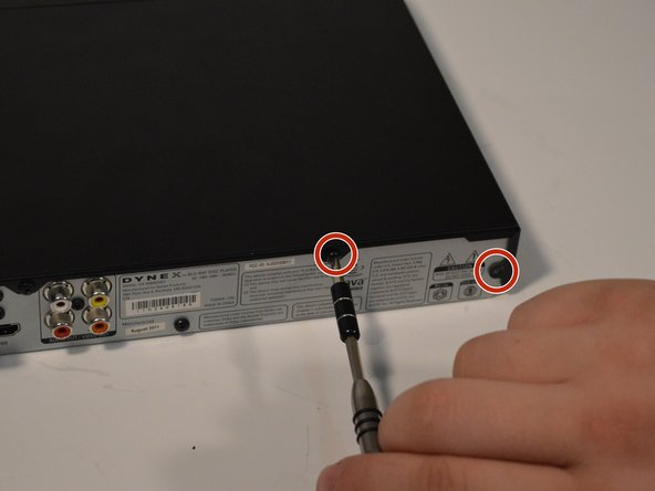 Use a Phillips #1 screwdriver to remove the four 5mm screws that connect the black outer shell to the silver back of the device.