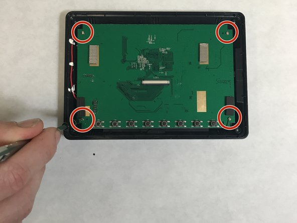 Remove the 4 M2x1.5-7 screws (7mm length) from the green PCB board.