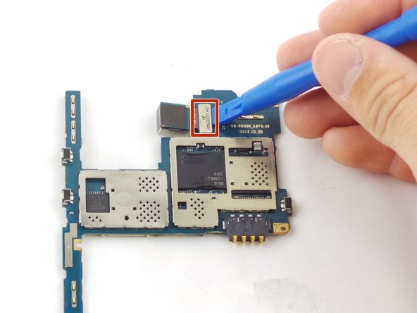 Remove the motherboard and unhook the ribbon cable clip to the back camera.