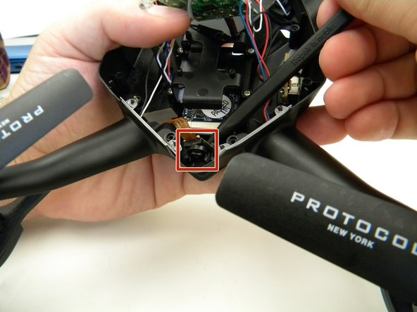Remove the camera by gently prying it out of the bracket with the spudger.