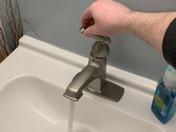 Turn the hot water on at a nearby faucet and leave it running to relieve any pressure in the tank and vent the water heater as it drains.