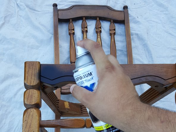 Holding the spray paint 6-12 inches away from the chair, apply a light coat of paint.