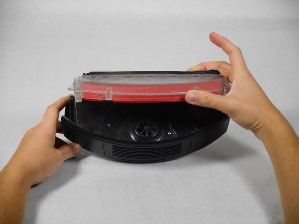 Remove the top of the vacuum bin by pulling it straight up.