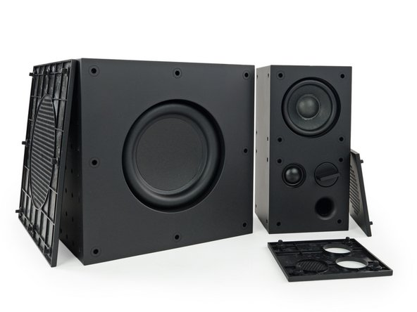 """We turn to the new FREKVENS combo and see, like on the Eneby 8"""", removable front covers that reveal some speaker and a reflex vent on the smaller one."""