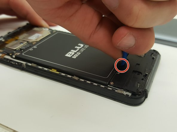 There is a patch of adhesive underneath the battery, which can make it difficult to remove.