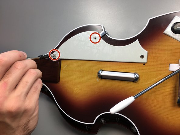 Flip the guitar to the front, with the strummer and fret buttons facing you.