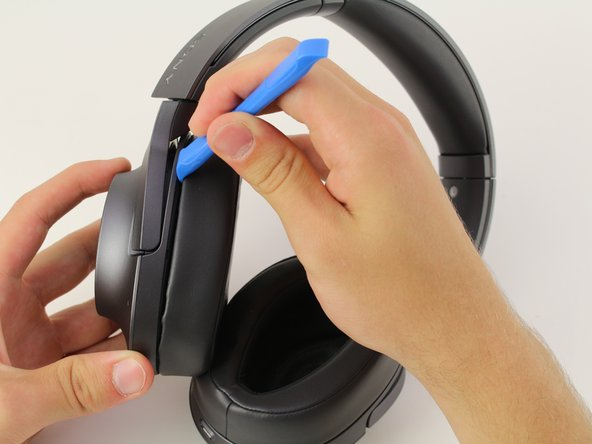 Start by inserting the iFixit plastic opening tool into the crease between the hard plastic and the ear cup on the right side of the headphones. Then you should gently apply pressure until it separates.
