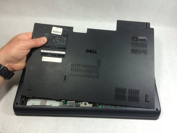 Use a plastic opening tool to pry the panel away from the laptop body