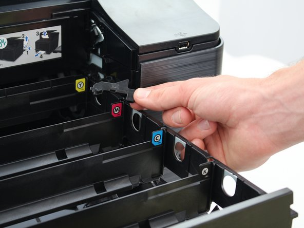 Repeat steps 4 and 5 for the lock on the opposite side of the printer.