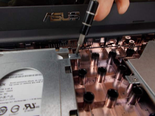 Remove all screws holding the hard drive in place.