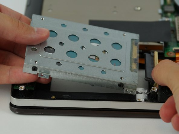 Lift up and separate the hard drive from the battery connection.
