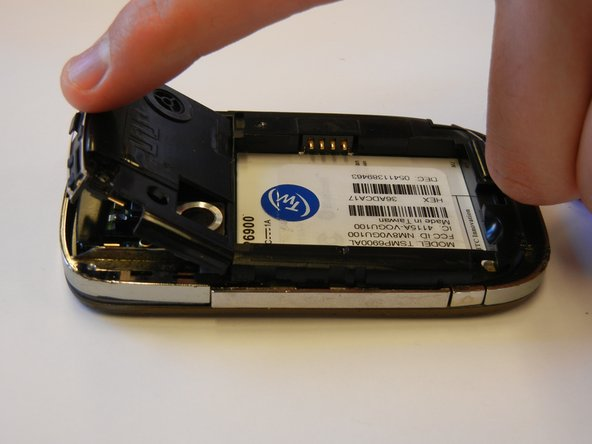 Remove the plastic speaker casing above the battery slot.