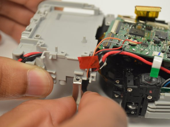 Remove the metal frame from battery housing unit manually.