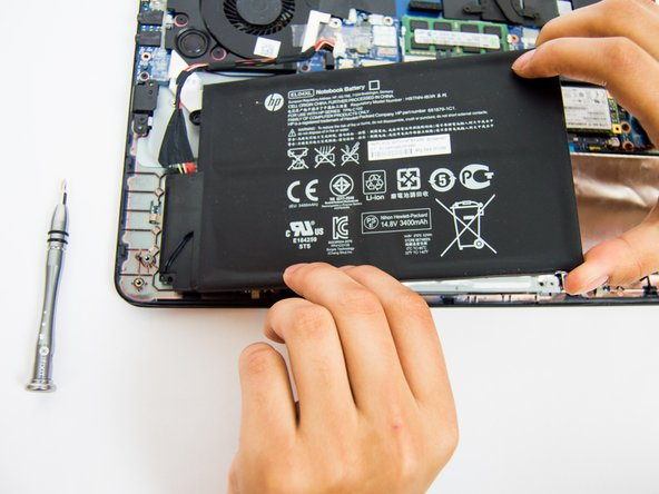Then slowly remove the battery from the right side of the battery and then raise it up.