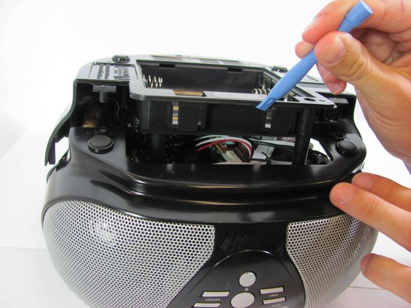 Once the pieces are separated, pull them apart and place the bottom cover aside, near the stereo.