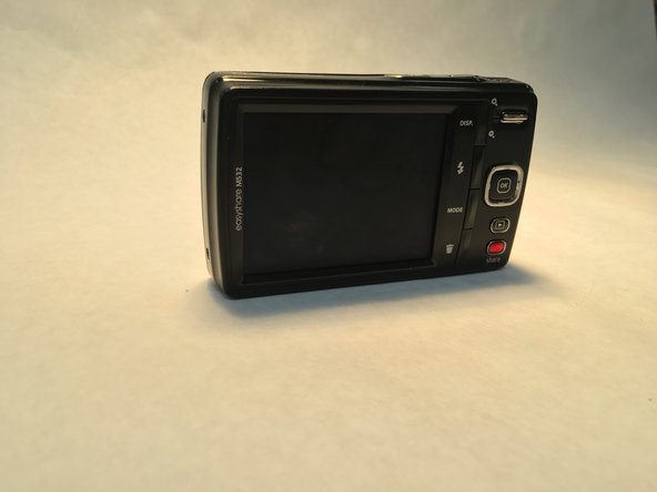 Open the battery compartment on the bottom of the camera and remove the battery.