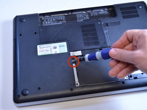 Image 1/1: Use a Phillips #0 screwdriver to remove the screw.