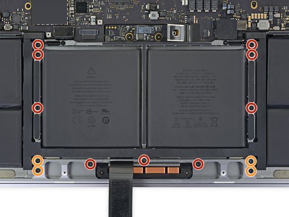 Use a T5 Torx driver to remove the 13 screws securing the trackpad assembly: