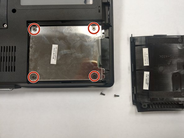 Once you have removed the section of the case covering the hard drive, you will see a metal cover over the hard drive.