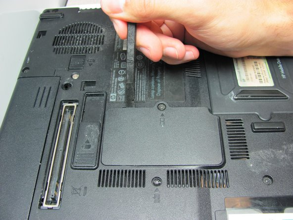 Once the screw is removed, use a spudger to pry open the case covering the RAM chip.
