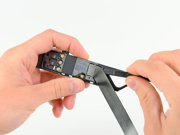 Image 1/2: Remove the AirPort/Bluetooth cable from the AirPort/Bluetooth assembly.