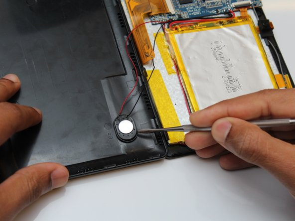 Using a spudger gently remove the speaker from the back of the device.