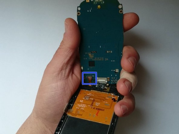 Lift up the board and disconnect the Touchscreen flex cable.